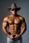 Muscular male in a hat and sunglasses
