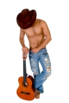 man in cowbow hat holding guitar on an isolated white background